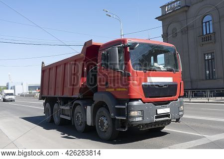 Red Lorry At The City Crossroads. Freight Transport Equipment In The City.