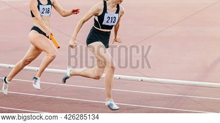 Women Relay Race Running Track And Field Competition