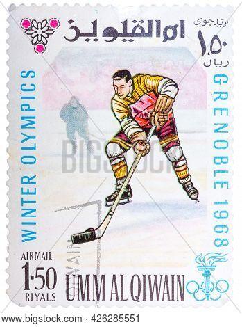 Umm Al-quwain - Circa 1968: Stamp Printed By Umm Al-quwain, Shows Hockey Player Bats The Puck, Circa