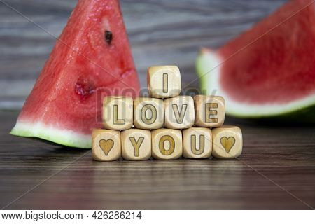 I Love You. The Word About Love Is Written On Wooden Cubes On A Background Of Watermelons. Declarati