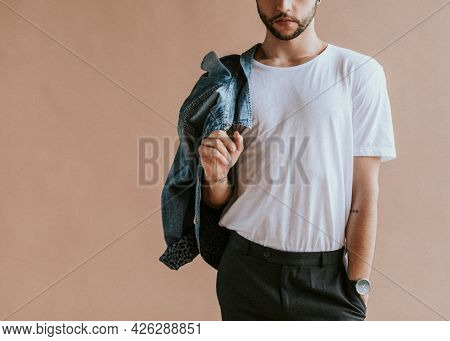 Bearded man in a white tee