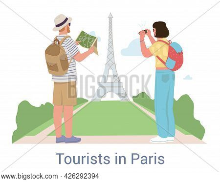 Tourists On Vacation In Paris Sightseeing At The Eiffel Tower With A Couple Of Backpackers Using A R