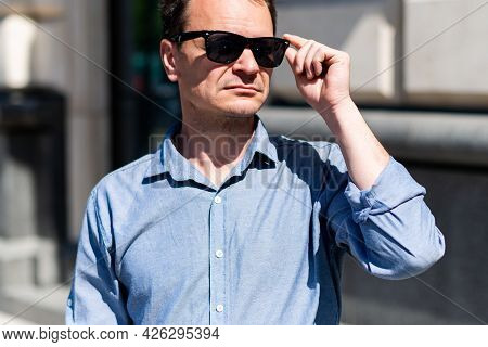 Caucasian Man Forty Years Old Businessman In The City In Summer.