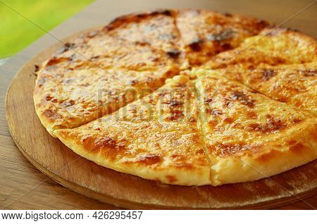 Closeup Of Fresh Baked Khachapuri Imeruli (imeretian) Or Cheese-filled Georgian Flatbread On Wooden