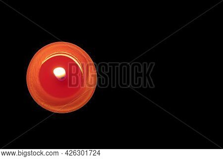 Lit Red Candle On A Black Background. Memory Concept. Copy Space. Top View.