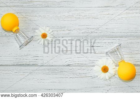 Delicate Chamomile Close-up With Anti-cellulite Vacuum Massage Cups.