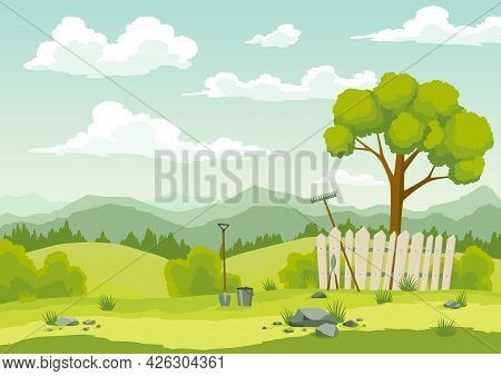 Spring Landscape With Green Grass, Hills, Blue Sky With Clouds And Farm Implements. Nature Countrysi