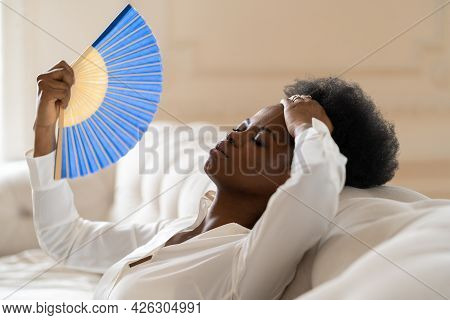 Tired Afro Business Woman Suffering From Heatstroke Or Hot Summer Flat Without Air-conditioner, Touc