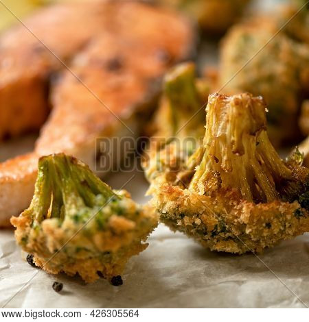 Close Up Of Broccoli Cabbage Fried In Breadcrumbs. Vegetable Garnish For Salmon Steak. Soft Focus.
