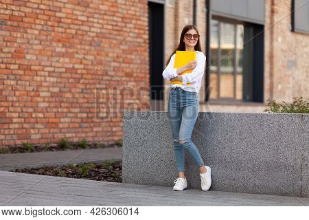 Hesitant People. A Young Pretty Student On Campus. University Studies.