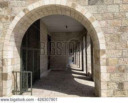 Jerusalem, Israel - March 08, 2021: Gallery Along The Side Facade Of The Papal Center Notre Dame Jer