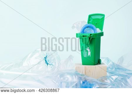 Plastic Garbage With Green Colored Trash Can.
