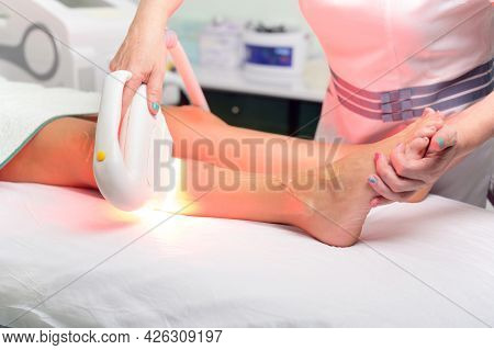 Laser Epilation And Cosmetology In Beauty Salon. Cosmetology, Spa And Hair Removal Concept. High Qua