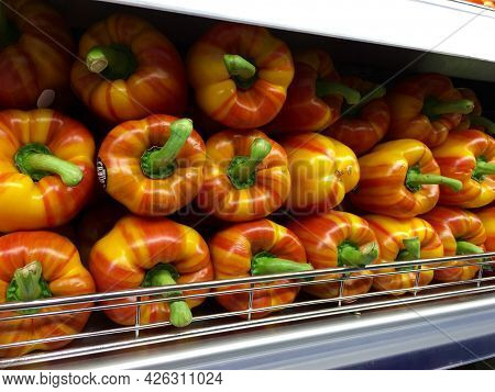 Fall Colored Heirloom Bell Peppers On The Shelf In The Supermarket