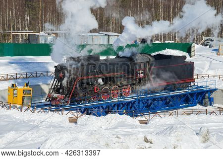 Ruskeala, Russia - March 10, 2021: Soviet Mainline Freight Steam Locomotive L-2198 Turns Around On A