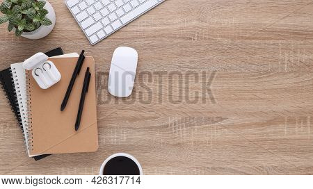 Top View Wooden Workspace Office Desk With Computer And Office Supplies. Flat Lay Work Table With Bl