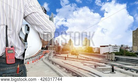 Rear View Architect Man Standing And Checking Railway Construction And Working On Skytrain With Hard