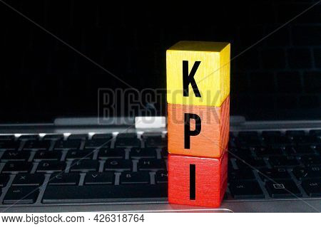 Laptop, Colored Cubes With Kpi Letters. Business Concept