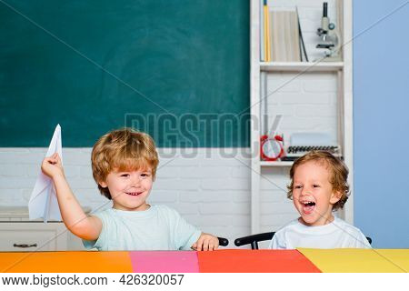 Cute Little Preschool Kid Boy Study In A Classroom. Educational Process. Elementary School And Educa