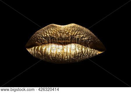 Closeup Sexy Beautiful Female Golden Lips Isolated. Gold Lipstick. Gold Lips. Gold Paint From The Li