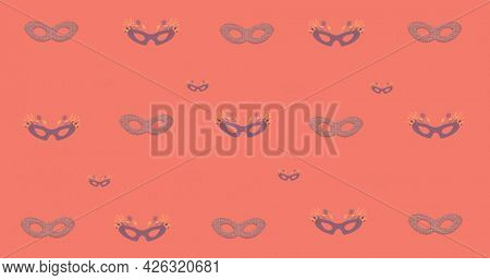 Composition of masquerade masks repeated in rows, on salmon pink background. fashion, beauty and accessories background pattern concept digital animation.