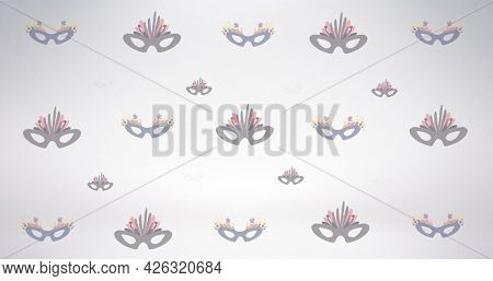 Composition of masquerade masks repeated in rows, on pale grey background. fashion, beauty and accessories background pattern concept digital animation.