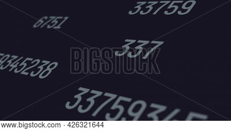Sets of random numbers with a grey font color projected on a black screen background. each set of numbers are constantly changing at a fast pace. random numbers