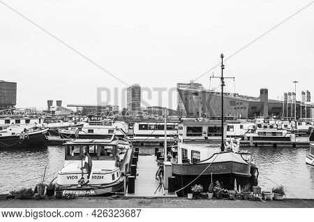 Amsterdam, Netherlands. June 06, 2021. Beautiful View To A Shipping Channel And Bridges. Black And W