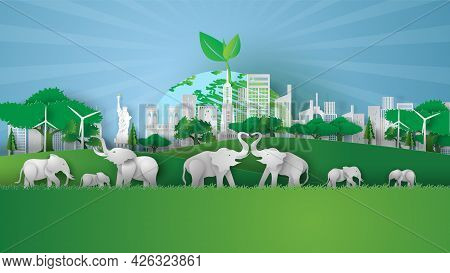 Animal Wildlife In Green Park Landmarks Cityscape. Creative Paper Cut And Craft Style. Elephants In