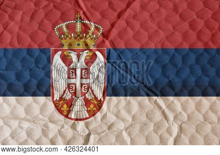Flag Of State Of Serbia On An Uneven Textured Surface. National Flag Of Country Located On Balkan Pe