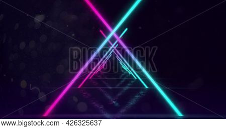 Image of glowing neon turquoise and pink triangle outlines moving towards camera in hypnotic motion in repetition on black background. Neon kaleidoscopic motion concept digitally generated image. 4k