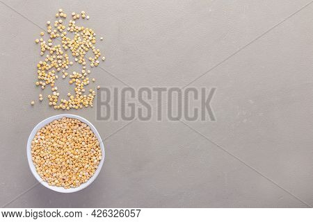 Legumes In Bowl And Scattered In The Background, Yellow Peas In A Plate On A Gray Background, Top Vi