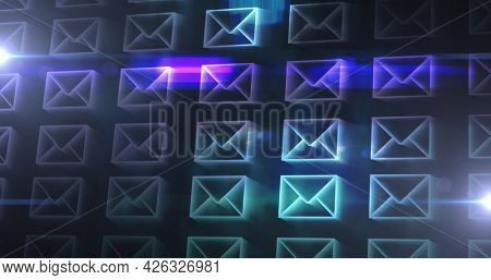 Image of rows of digital envelopes with glowing light trails. global online network technology connection communication concept digitally generated image.