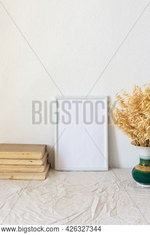 Home Decor Mock-up, Blank Picture Frame Near White Painted Concrete Wall ,vase With Dried Yellow Oat