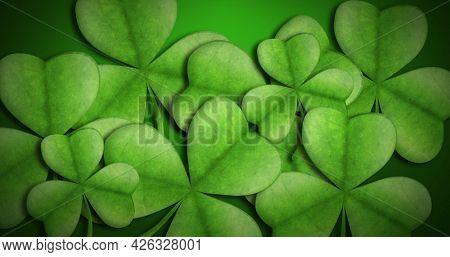 Image of St Patricks Day multiple light and dark green shamrocks clover leaves on gradient green background. Celebration of Irish culture concept digitally generated image. 4k