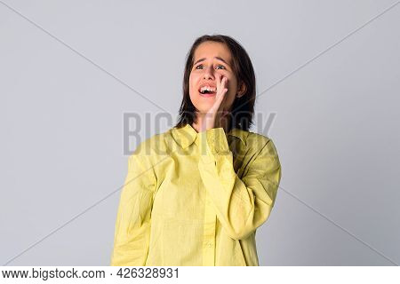 Do Not Tell Anyone. Talkative Mysterious Pretty Girl Dressed In Yellow Shirt Is Saying Secret Hot Br