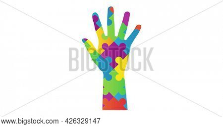 Image of multi coloured puzzle elements forming hand Autism Awareness Month symbol on white background. Autism awareness support concept digitally generated image.