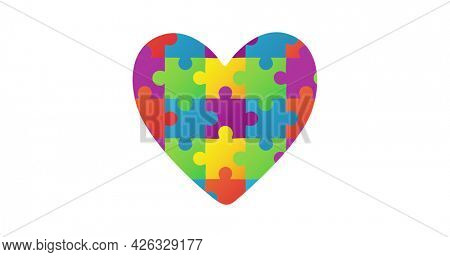 Image of multi coloured puzzle elements forming heart Autism Awareness Month symbol on white background. Autism awareness support concept digitally generated image.