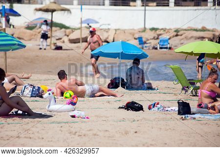 Spain, Torrevieja, 28.06.2021, People On The Beach Of Mediterranean Sea In Torrevieja City, Alicante