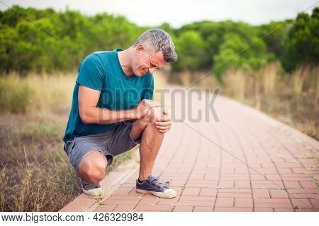 Knee Pain. Man With Leg Injury. Healthcare And Medicine Concept