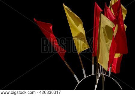 Texture Of Multi-colored Festive Red, Yellow Flags Made Of Fabric. Holiday Celebration Satin Flags O