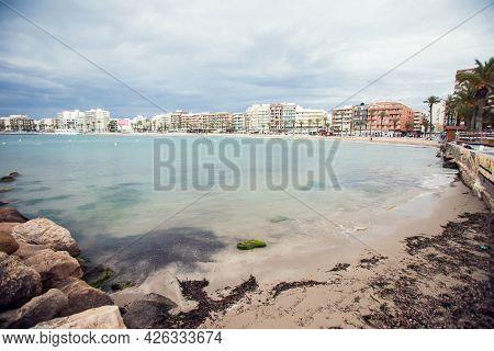 Torrevieja, Spain, 27.04.2021, Sandy Beach Of Mediterranean Sea In Torrevieja City.