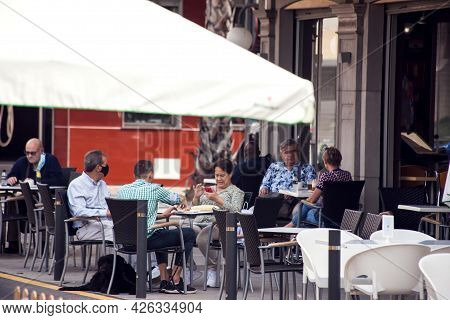 Torrevieja, Spain, 30.04.2021. Restaurant Reopen In Covid-19 Time. Customers Sitting At Tables In A