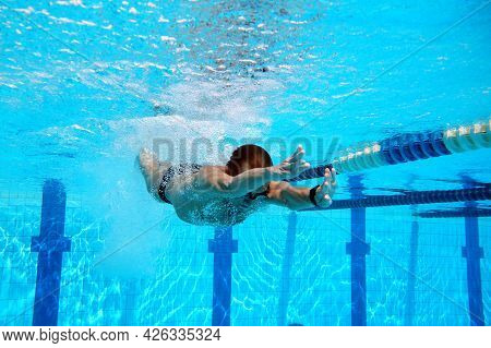 Swimmer In The Big Outdoor Swimming Pool