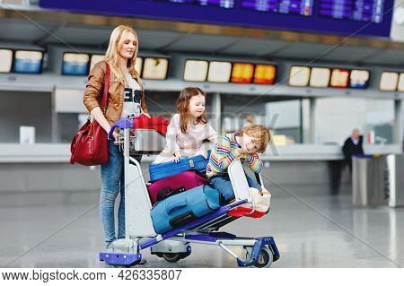 Two Little Kids, Boy And Girl, Siblings And Mother At The Airport. Children, Family Traveling, Going
