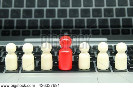 Peg Doll Red Leader And Other Followers With Laptop Background