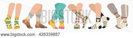 Legs In Socks. Women And Men Wearing Fashionable Socks. Flat Cartoon Colorful Sock With Trendy Patte