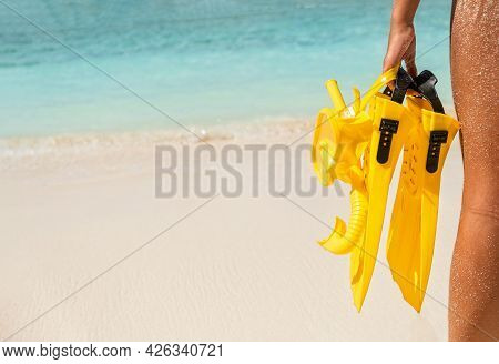 Young Girl With Yellow Snorkelling Equipment Standing By The Sea. Summer Holiday And Travel Concept