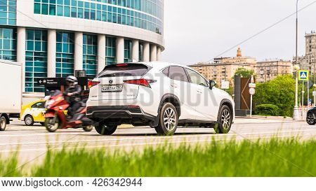 Moscow, Russia - May 2021: Lexus Nx 200 Is Accelerating In City Road On Urban Background