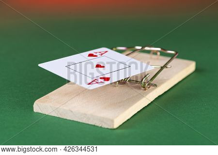Playing Card And Mousetrap, Game Trap, On A Green Background, Get Into Gambling Addiction